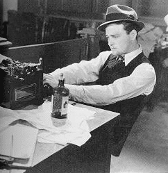 Picture of 1950s editor looking at press releases